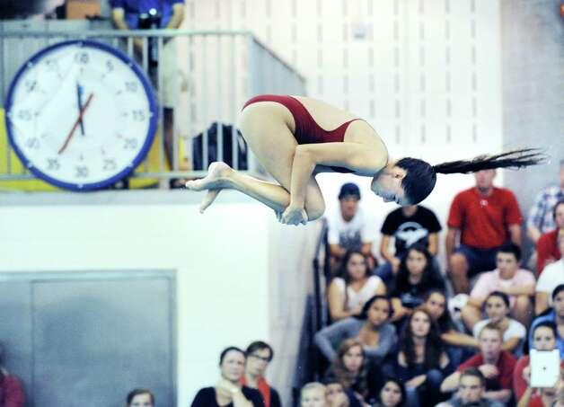 Greenwich High School diver Ines Villemure competes during the girls high school swim meet between Greenwich High School and Darien High School at Greenwich, Wednesday afternoon, Oct. 3, 2012. Photo: Bob Luckey / Greenwich Time