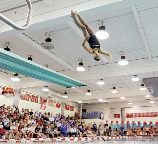 Darien diver Olivia Piazza competes during the girls high school swim meet between Greenwich High School and Darien High School at Greenwich, Wednesday afternoon, Oct. 3, 2012. Photo: Bob Luckey / Greenwich Time