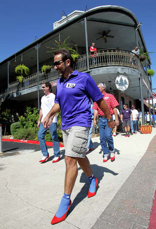 "Men of Kendall County participate in ""Walk a Mile in Her Shoes"" to benefit the Kendall County Women's Shelter in downtown Boerne on October 3, 2012. Photo: Tom Reel, San Antonio Express-News / ©2012 San Antono Express-News"