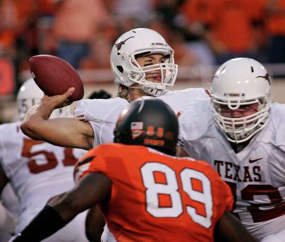 STILLWATER, OK - SEPTEMBER 29:   Quarterback David Ash #14 of the Texas Longhorns looks to throw against the Oklahoma State Cowboys on September 29, 2012 at Boone Pickens Stadium in Stillwater, Oklahoma. Texas defeated Oklahoma State 41-36. Photo: Brett Deering, Getty Images / 2012 Getty Images