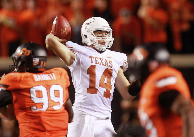 Texas quarterback David Ash (14) passes against Oklahoma State during an NCAA college football game in Stillwater, Okla., Saturday, Sept. 29, 2012. (AP Photo/Sue Ogrocki) Photo: Sue Ogrocki, Associated Press / AP