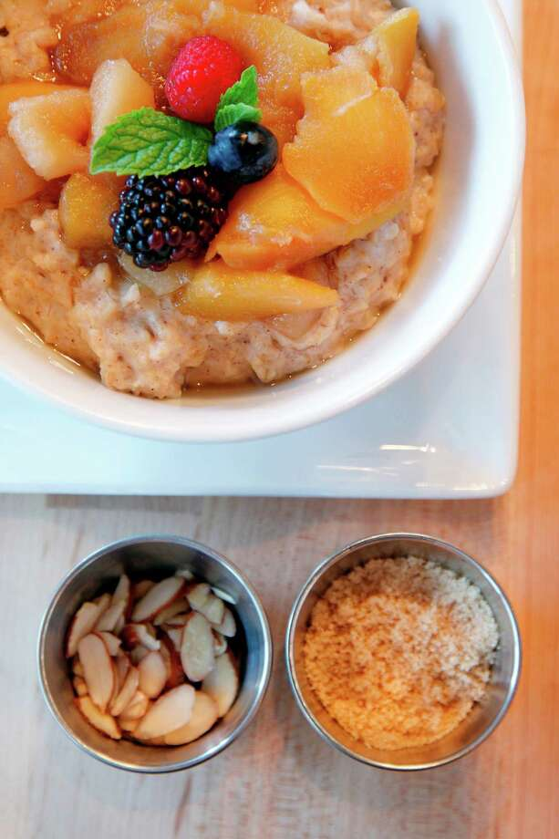 Steel-Cut Oats with Seasonal Fruit Compote comes with almonds and milk.  on Thursday, Sept. 13, 2012, in Houston. Adair Kitchen serves American cuisine. ( Mayra Beltran / Houston Chronicle ) ( Mayra Beltran / Houston Chronicle ) Photo: Mayra Beltran / 2012 Houston Chronicle