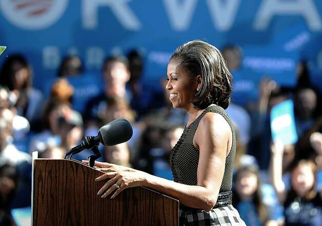 First lady Michelle Obama smiles as she is greets supporters on the University of Nevada Reno campus on Wednesday, Oct. 3, 2012 in Reno, Nev.. Photo: Photo By Andy Barron, Associated Press