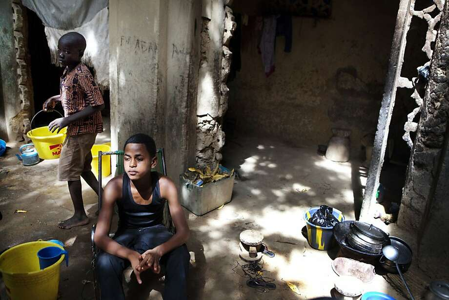 Salif Haidara, 16, sits in the home a friend in Mopti, Mali, where Islamists offered him and his family money for him to fight, but he declined. Photo: Associated Press