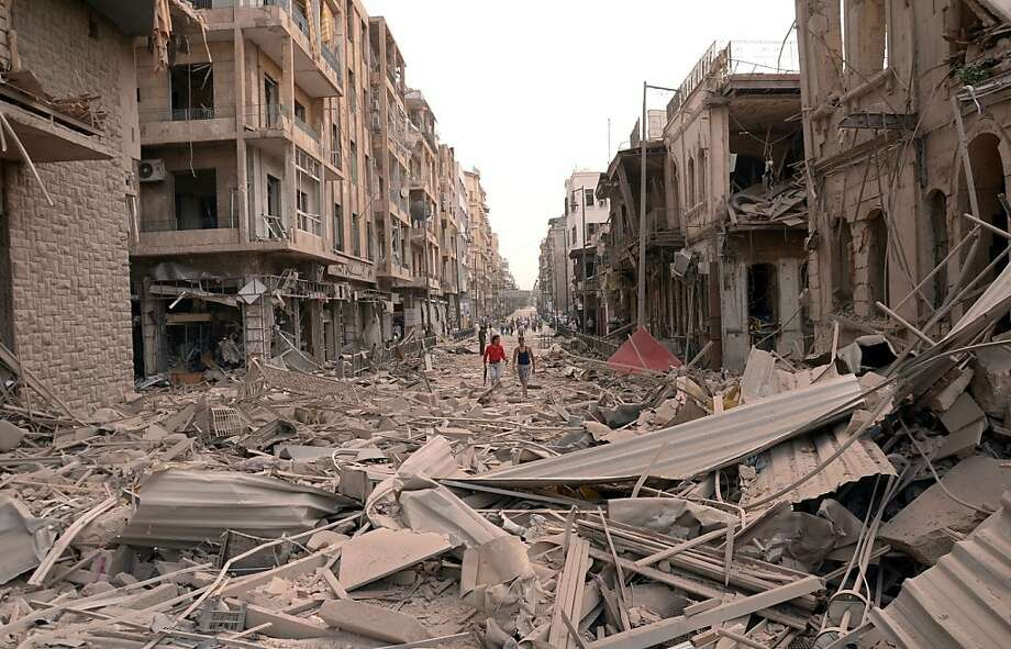 A handout picture released by the Syrian Arab News Agency (SANA) shows what the official agency described as the scene of car bomb explosions that hit the northern Syrian city of Aleppo on October 3, 2012. Three car bombs tore through the heart of Syria's commercial capital in the morning, killing at least 27 people and wounding 72 others, a city official told AFP. Photo: -, AFP/Getty Images