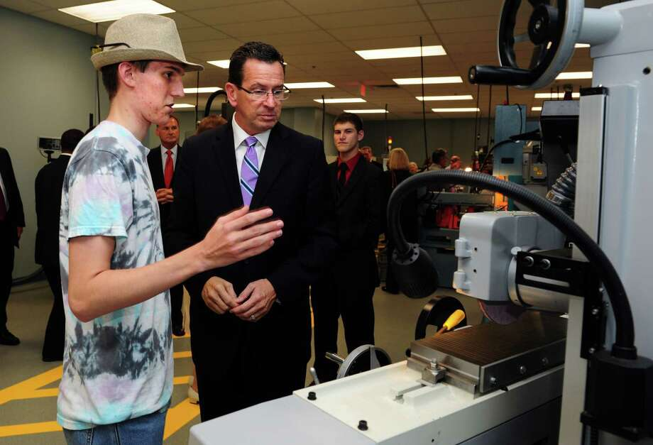 Student Austin Otis, 19, of Trumbull, talks with Gov. Dannel Malloy during a tour Housatonic Community College's new Regional Advanced Manufacturing Center Wednesday, Oct. 3, 2012.   The HCC facility features a newly designed manufacturing lab on the Bridgeport campus. Photo: Autumn Driscoll / Connecticut Post