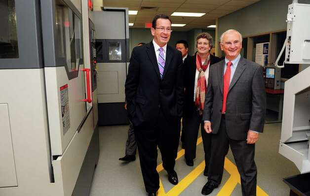 Gov. Dannel Malloy and Board of Regents President Bob Kennedy tour Housatonic Community College's new Regional Advanced Manufacturing Center Wednesday, Oct. 3, 2012.   The HCC facility features a newly designed manufacturing lab on the Bridgeport campus. Photo: Autumn Driscoll / Connecticut Post