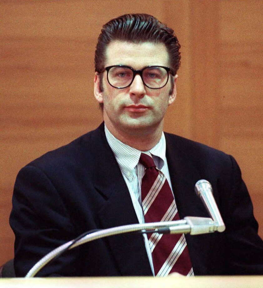 Alec Baldwin in some hipster glasses back in 1996, when he took the stand at his misdemeanor assault trial in California. Baldwin, accused of hitting a photographer, was acquitted.  Photo: KIM KULISH, Getty / AFP