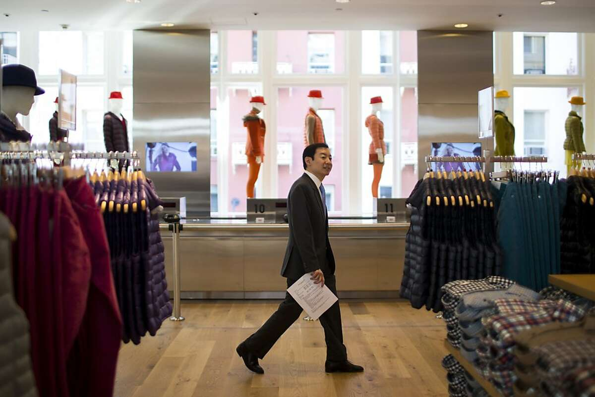 Uniqlo USA COO Yasunobu Kyogoku walks between isles of clothing at Uniqlo's first West Coast flagship store on Powell St. in San Francisco, Calif. on Wednesday, Oct. 3, 2012.