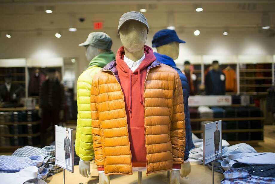 Uniqlo's lightweight down jacket, which is advertised as weighing less than an egg, is displayed on mannequins at the new store. Photo: Stephen Lam, Special To The Chronicle