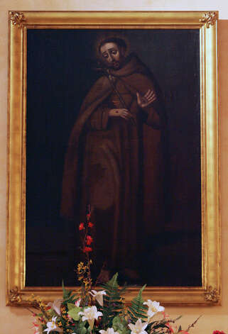 A colonial era painting of St. Francis of Assisi hangs on the wall at Mission Concepción. The artist is unknown. Photo: JOHN DAVENPORT, SAN ANTONIO EXPRESS-NEWS / jdavenport@express-news.net