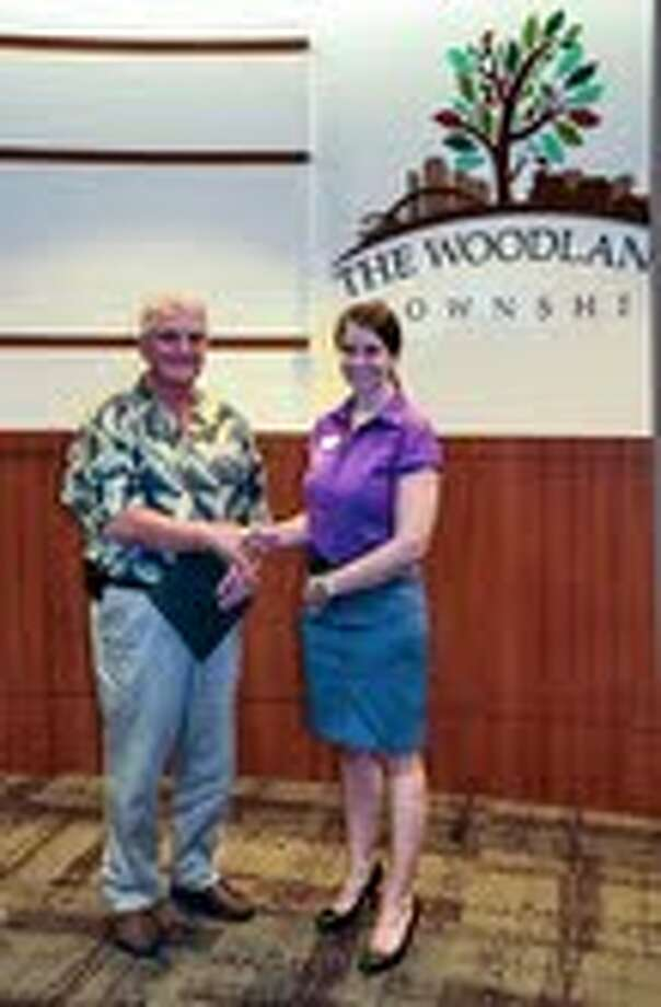 Mike Bass of The Woodlands Township Board of Directors and Kiri Cook Soprano of Alzheimer's Association, Houston and Southeast Texas Chapter after the Board of Directors declared September as World Alzheimer's Month.