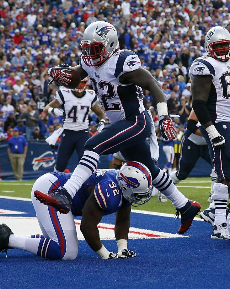 Steven Ridley and the Patriots ran over Alex Carrington and the Bills on Sunday, scoring 45 points in a second-half stretch of less than 22 minutes for a 52-28 win. Photo: Bill Wippert, Associated Press