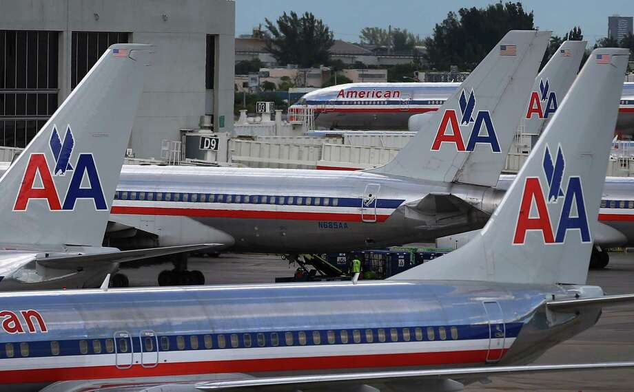 American Airline planes wait at Miami International Airport. Last month saw nearly 1,400 American flights canceled. Photo: Joe Raedle / 2012 Getty Images