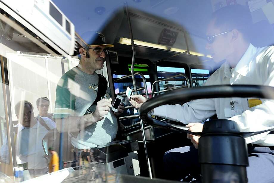 Travelers board the AirBART bus heading to Oakland International Airport at the Coliseum BART Station. Photo: Michael Short, Special To The Chronicle