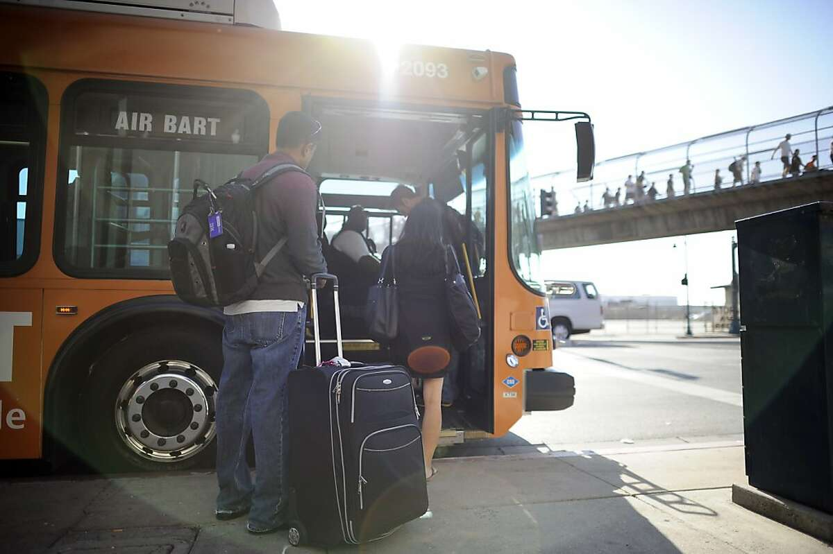 Travelers board the AirBart bus heading to the airport at the Coliseum Bart station in Oakland, CA Wednesday October 3rd, 2012.
