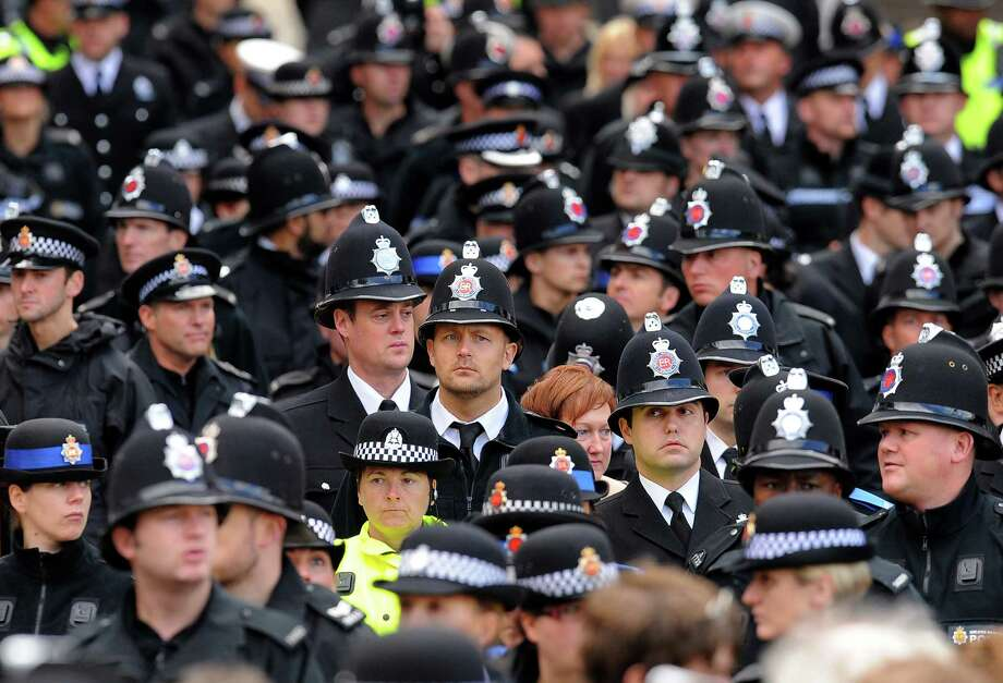 British police personnel attend the funeral of murdered police colleague Nicola Hughes at Manchester Cathedral in Manchester, north-west England on October 3, 2012. Photo: ANDREW YATES, AFP/Getty Images / AFP