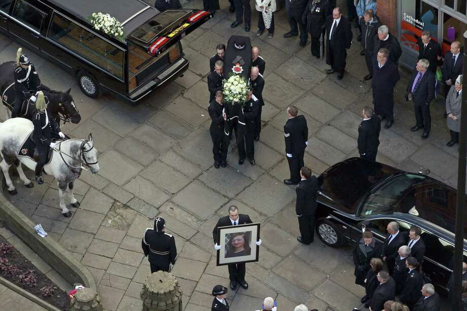 Pallbearers carry the coffin into the cathedral during the funeral of police Constable Nicola Hughes at Manchester Cathedral on October 3, 2012 in Manchester, England. Photo: WPA Pool, Getty Images / 2012 Getty Images