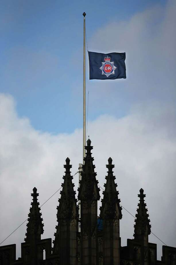 A Greater Manchester Police flag flies at half mast ahead of the funeral of police Constable Nicola Hughes at Manchester Cathedral on October 3, 2012 in Manchester, England. Photo: Dan Kitwood, Getty Images / 2012 Getty Images