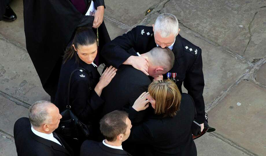 Mourners react as the coffin of Greater Manchester Police constable Nicola Hughes is carried from Manchester Cathedral after her funeral service October 3, 2012 in Manchester, England. Photo: WPA Pool, Getty Images / 2012 Getty Images