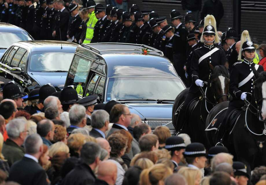 The cortege bearing the body of murdered police woman Nicola Hughes arrives for a funeral service at Manchester Cathedral in north-west England, on October 3, 2012. Photo: ANDREW YATES, AFP/Getty Images / AFP