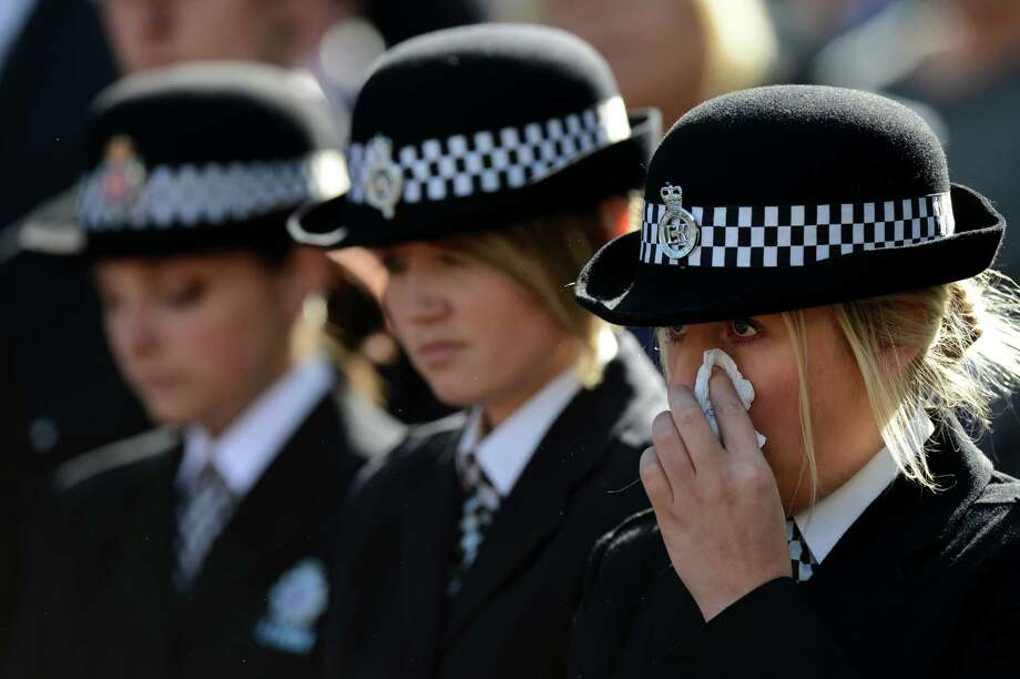 British police personnel attend the funeral of murdered police colleague Nicola Hughes at Manchester Cathedral in Manchester, north-west England on October 3, 2012. PC Nicola Hughes, 23, and PC Fiona Bone, 32, were killed in a gun and grenade attack as they responded to what they thought was a routine burglary call in Tameside, Greater Manchester, northwestern England, on September 18, 2012. Photo: BEN STANSALL, AFP/Getty Images / AFP