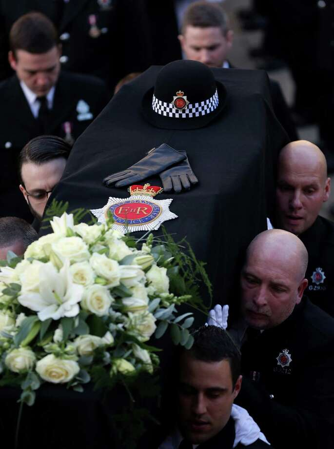 The coffin of police Constable Nicola Hughes is carried out of  Manchester Cathedral after her funeral service on October 3, 2012 in Manchester, England. Photo: CHRISTOPHER FURLONG, AFP/Getty Images / 2012 Getty Images