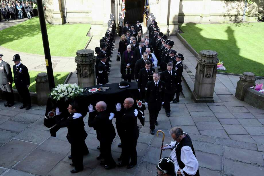 The coffin of police Constable Nicola Hughes is carried out of  Manchester Cathedral after her funeral service on October 3, 2012 in Manchester, England. Photo: CHRISTOPHER FURLONG, AFP/Getty Images / AFP
