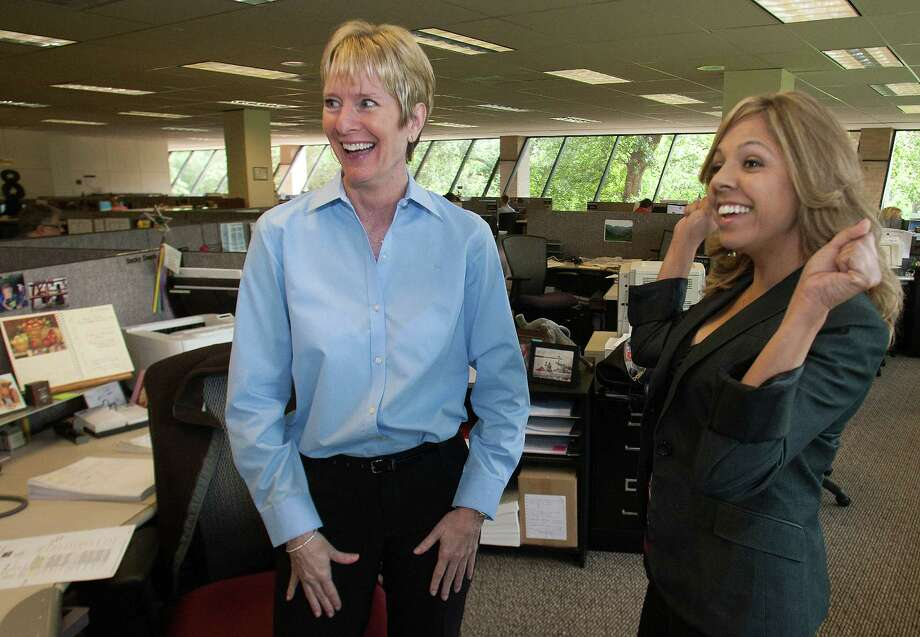 Becky Deane, left, talks with co-worker Teresa Trifilio. Their company offers extra time off for employees with at least five years of service. Deane will help her daughter get ready for a new baby. Trifilio will cover for her. Photo: J. Patric Schneider / © 2012 Houston Chronicle