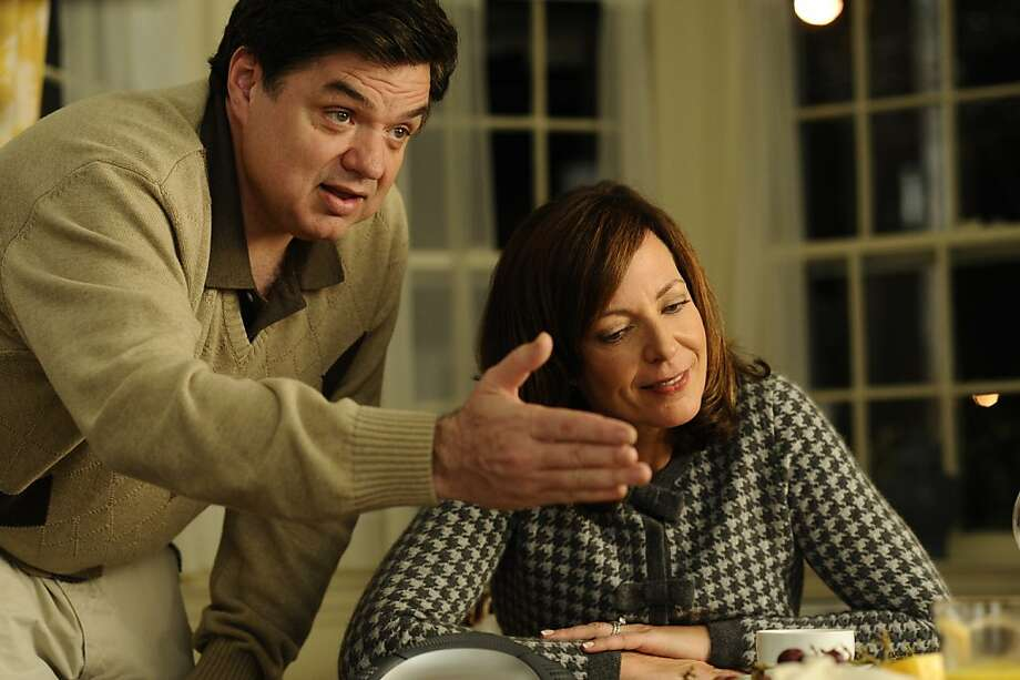 "Oliver Platt and Allison Janney play the Ostroffs, a couple whose daughter has an affair with a neighbor in ""The Oranges."" Photo: Myles Aronowitz, ATO Pictures"
