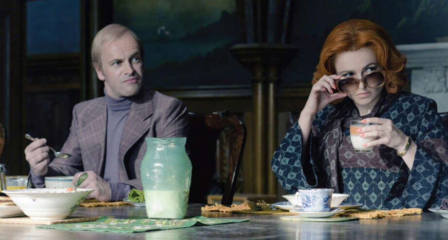 Jonny Lee Miller as Roger Collins, Helena Bonham Carter as Dr. Julia Hoffman. Photo: Peter Mountain / © 2012 Warner Bros. Entertainment Inc. - U.S., Canada, Bahamas & Bermuda. © 2012 Village Roadshow Films (BVI) Limited – All other territories.