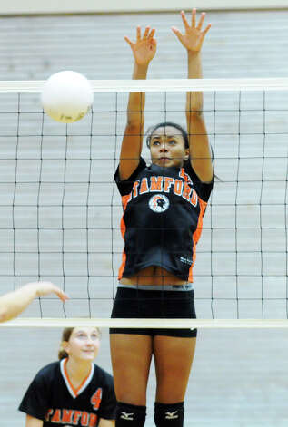 Stamford's Brianna Gordon blocks as Stamford High School hosts St. Joseph in a girls volleyball game in Stamford, Conn., Oct. 3, 2012. Stamford won 3-0. Photo: Keelin Daly / Stamford Advocate