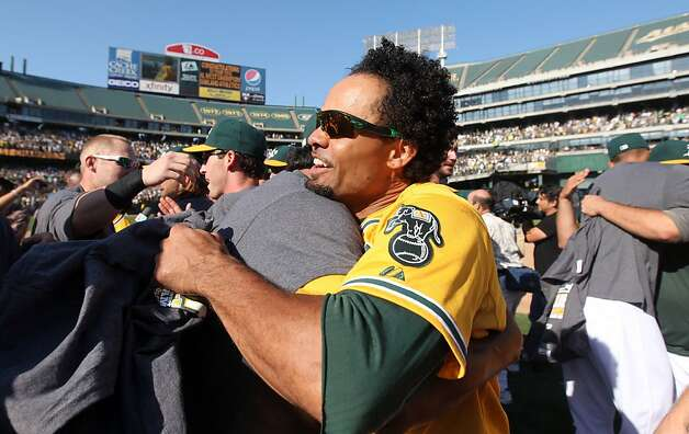 Oakland Athletics Coco Criisp celebrates with his teammates their 12-5 championship win over the Texas Rangers Wednesday October 3, 2012 in Oakland California Photo: Lance Iversen, The Chronicle