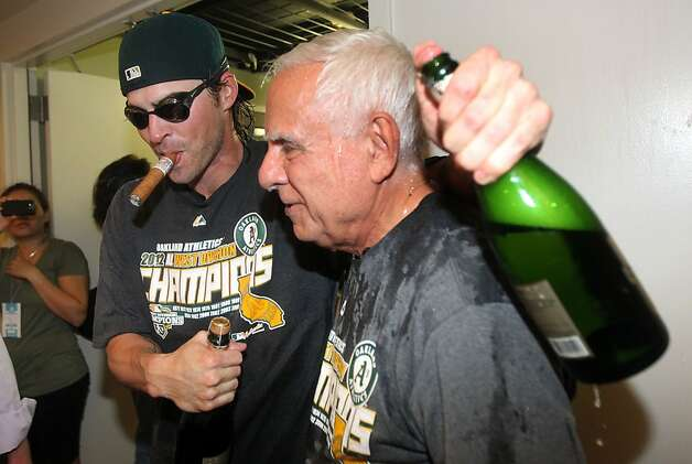 Oakland Athletics Josh Reddick celebrates with A's team owner Lou Wolff in the club house after their 12-5 championship win over the Texas Rangers Wednesday October 3, 2012 in Oakland California Photo: Lance Iversen, The Chronicle