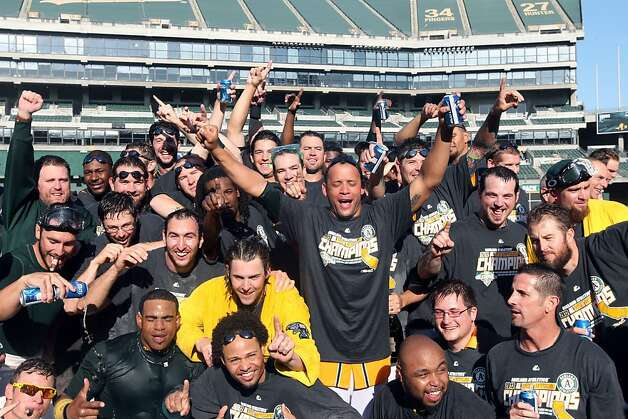 Oakland Athletics celebrated their 12-5 championship win over the Texas Rangers with a team portrait Wednesday October 3, 2012 in Oakland California Photo: Lance Iversen, The Chronicle