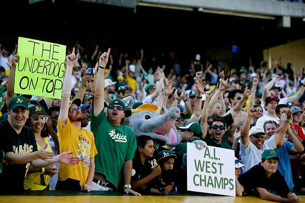 Oakland fans celebrate as the Oakland Athletics beat the Texas Rangers 12-5 in the last game of the season to clinch the American League West division in Oakland, Calif., on Wednesday October 3, 2012. Photo: Michael Macor, The Chronicle