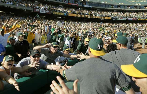 Oakland players thank the fans fllowing their victory, as the Oakland Athletics beat the Texas Rangers 12-5 in the last game of the season to clinch the American League West division in Oakland, Calif., on Wednesday October 3, 2012. Photo: Michael Macor, The Chronicle