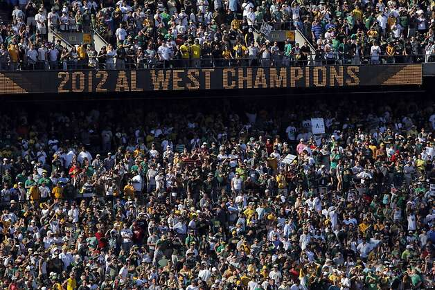 The coliseum scoreboard lights up with the A's title for 2012. The Oakland Athletics won the American League West division after they defeated the Texas Rangers at O.co Coliseum in Oakland, Calif., on Wednesday, October 3, 2012. Photo: Carlos Avila Gonzalez, The Chronicle