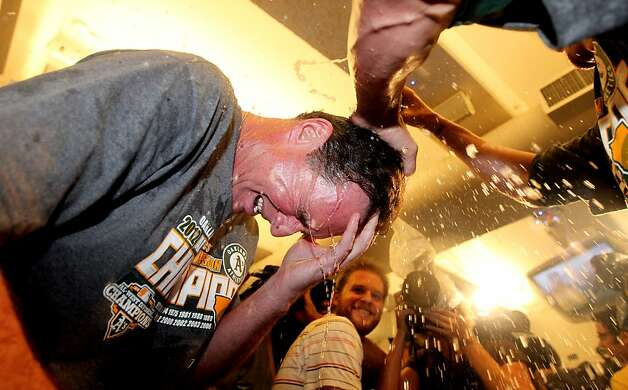 Oakland Athletics manager Bob Melvin celebrates their 12-5 championship win over the Texas Rangers with his team in the club house Wednesday October 3, 2012 in Oakland California Photo: Lance Iversen, The Chronicle
