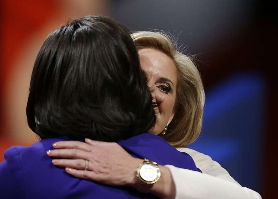 Ann Romney, right, hugs First lady Michelle Obama before the first presidential debate between President Barack Obama and Republican presidential nominee Mitt Romney at the University of Denver, Wednesday, Oct. 3, 2012, in Denver. (AP Photo/David Goldman) Photo: David Goldman, Associated Press