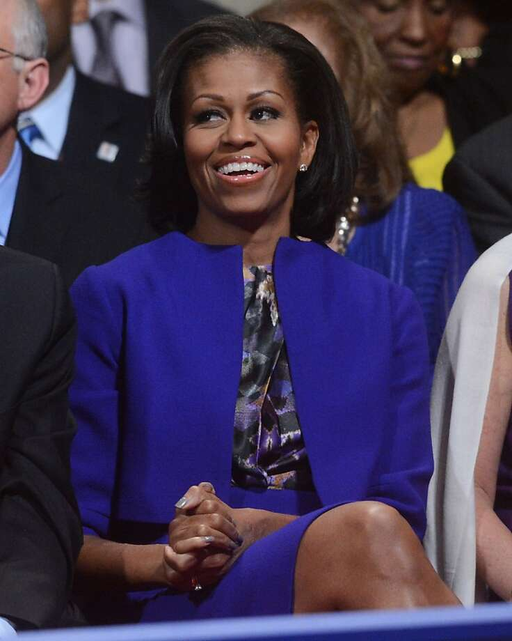 First lady Michelle Obama waits for the start of the first presidential debate at the University of Denver, Wednesday, Oct. 3, 2012, in Denver. (AP Photo/Pool-Michael Reynolds) Photo: Michael Reynolds, Associated Press