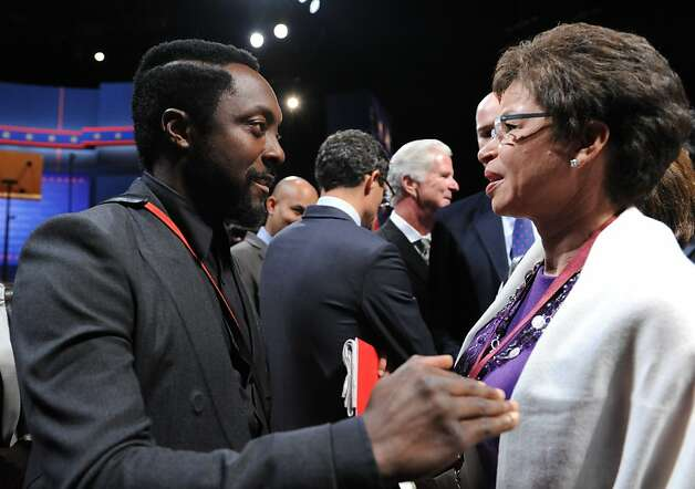 Rapper will.i.am (L) speaks with White House Senior Advisor to the US President Valerie Jarrett before the start of the first presidential debate between US President Barack Obama and Republican Presidential candidate Mitt Romney on October 3, 2012 in Denver, Colorado.    AFP PHOTO/Nicholas KAMMNICHOLAS KAMM/AFP/GettyImages Photo: Nicholas Kamm, AFP/Getty Images