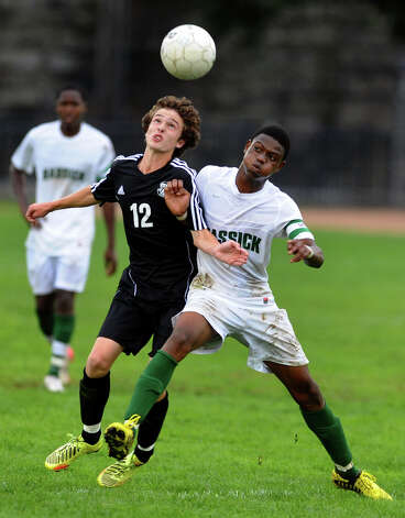 Trumbull''s #12 Christopher Anderson, left, and Bassick's #5 Richardson Joseph go after the ball, during boys soccer action at Went Field in Bridgeport, Conn. on Wednesday October 3, 2012. The game ended in a draw 0-0. Photo: Christian Abraham / Connecticut Post