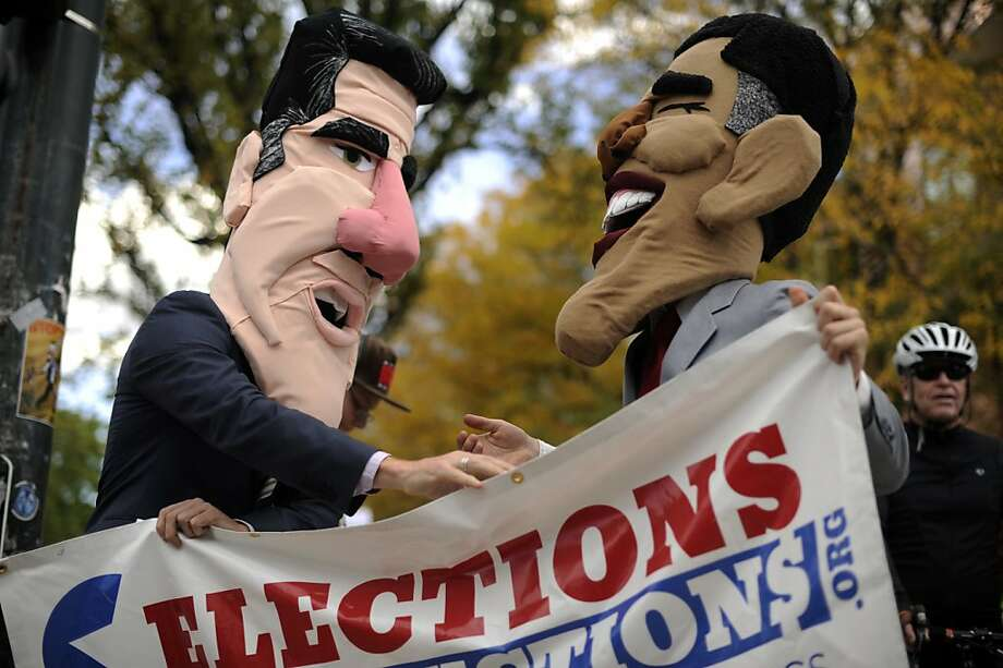 Joseph Huff, wearing a Mitt Romney mask, left, and Morgan Goodwin, wearing a Barack Obama mask, from Elections Not Auctions.org, protest outside the University of Denver before the first presidential debate of 2012, Wednesday, Oct. 3, 2012 in Denver. Photo: Hyoung Chang, Associated Press