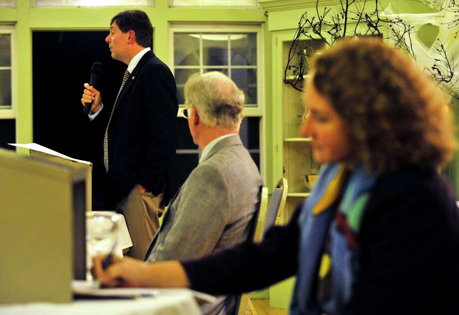 State Sen. Andrew Roraback, left, speaks as Curtis Read, chairman of The Northwest Conservation District, listens and Elizabeth Esty takes notes during the district's forum at the Lake Waramaug Country Club in New Preston on Wednesday, Oct. 3, 2012. Roraback, a Republican, and Esty, a Democrat, are vying for the 5th Congressional District. Photo: Jason Rearick / The News-Times