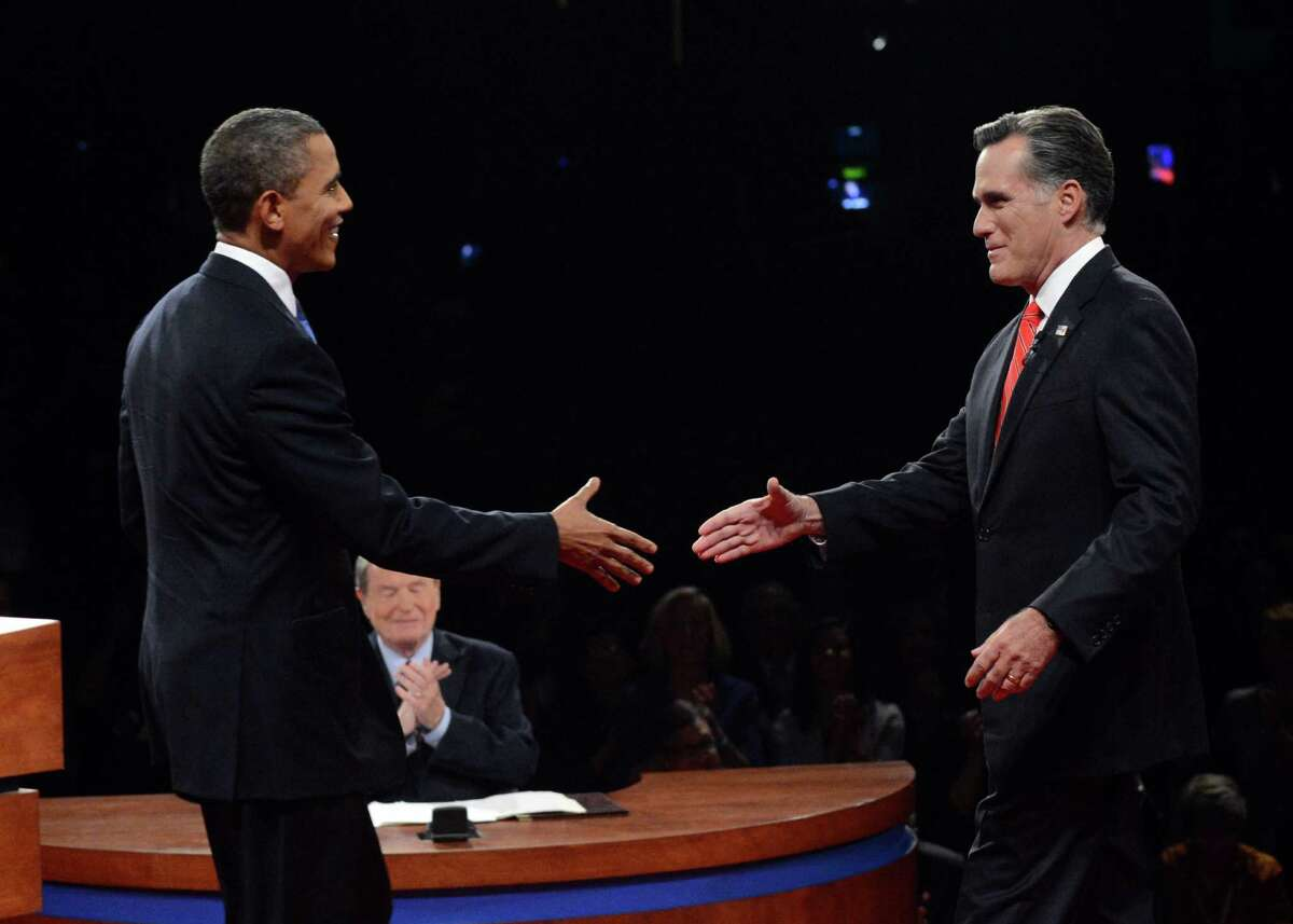 President Barack Obama shakes hands with Republican presidential nominee Mitt Romney during the first presidential debate at the University of Denver, Wednesday, Oct. 3, 2012, in Denver.