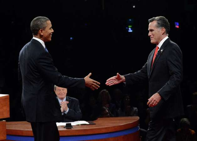 President Barack Obama shakes hands with Republican presidential nominee Mitt Romney during the first presidential debate at the University of Denver, Wednesday, Oct. 3, 2012, in Denver. Photo: Pool-Michael Reynolds