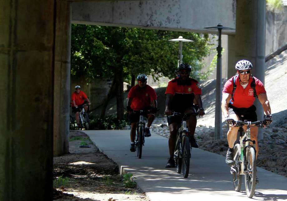 The Houston Fire Department bike team rides through the Buffalo Bayou on Wednesday, Oct. 3, 2012, in Houston. Photo: Mayra Beltran, Houston Chronicle / © 2012 Houston Chronicle