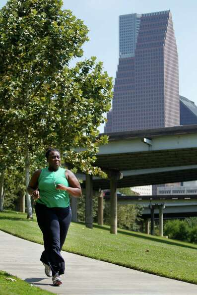 Ebonee Mathis runs through the Buffalo Bayou on Wednesday, Oct. 3, 2012, in Houston.