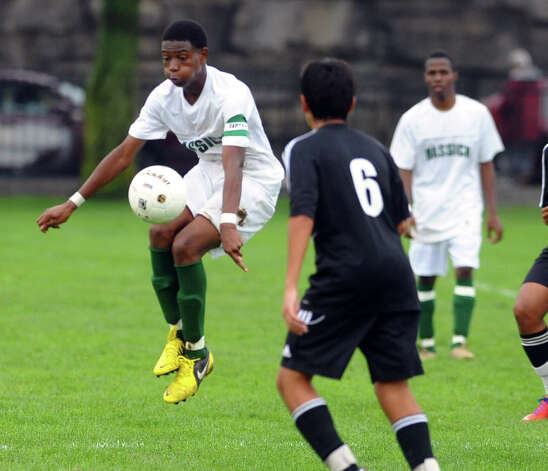 Trumbull''s #12 Christopher Anderson corrals the ball, during boys soccer action against Trumbull at Went Field in Bridgeport, Conn. on Wednesday October 3, 2012. The game ended in a draw 0-0. Photo: Christian Abraham / Connecticut Post